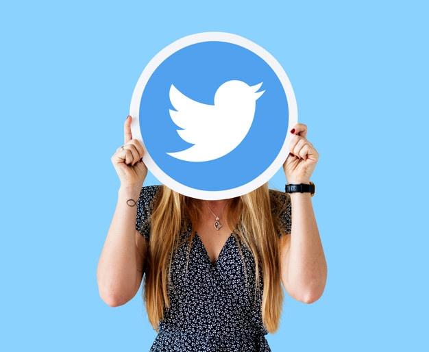 woman-showing-twitter-icon_53876-71119.jpg
